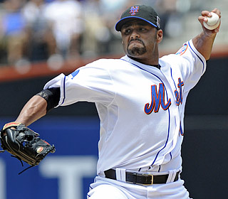 Johan Santana improves to 9-5, yielding two runs (one earned) on seven hits over seven innings.  (AP)