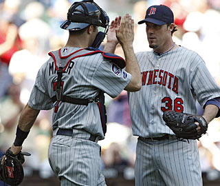 Catcher Joe Mauer gives credit to pitcher Joe Nathan, who picks up his 17th save. (AP)