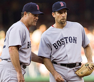 Pitching coach John Farrell talks with John Smoltz, who is encouraged with his first game in more than a year.  (AP)