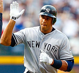 Alex Rodriguez tours the bases after another milestone home run and winds up with four RBI.  (Getty Images)