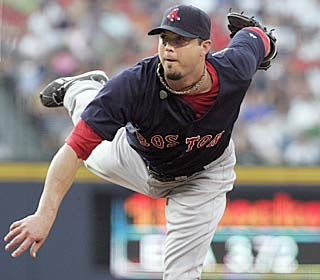 Josh Beckett strikes out six in seven innings to improve his record to 9-3.  (AP)