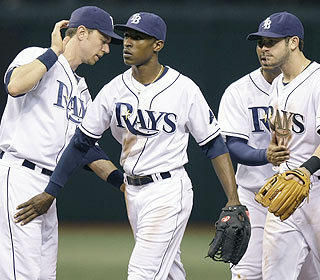 The Rays are quick to credit B.J. Upton (center) after his three-run double sets up the Rays' win. (AP)