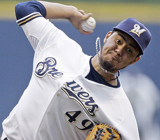Yovani Gallardo improves to 8-4, lasting until the eighth inning and giving up a run on four hits.  (AP)