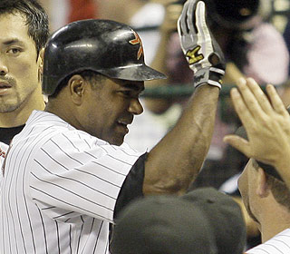 The props are flowing in the Houston dugout after Miguel Tejada's sacrifice fly in the eighth. (AP)