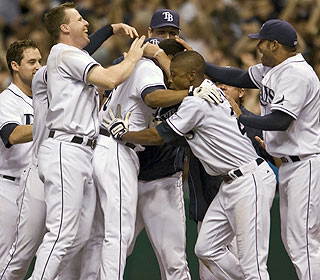 The wild celebration is on as the Rays move six games above .500 for the first time this season. (AP)