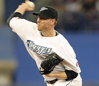 In his first start since June 12, Roy Halladay allows two runs and strikes out seven. (US Presswire)