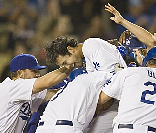 Three days after hitting three home runs in one game, Andre Ethier is a slugging hero again for L.A.  (AP)