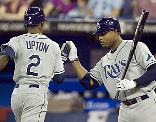 B.J. Upton, who begins the game with a leadoff HR, is congratulated by Carl Crawford, who also goes yard. (AP)
