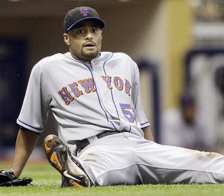 This isn't a typical stat line for Johan Santana: five earned runs, four walks and his sixth loss. (AP)