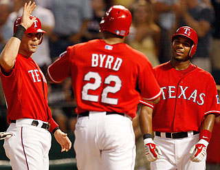 Touch 'em all: Marlon Byrd's second home run of the night earns a high-five from Michael Young.  (Getty Images)