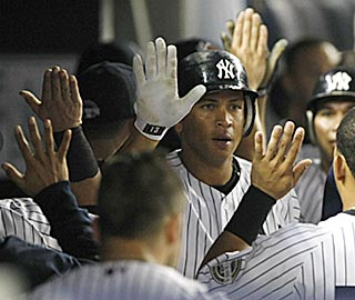Alex Rodriguez is a popular guy in the Yankees dugout after his two-run blast in the seventh.  (US Presswire)