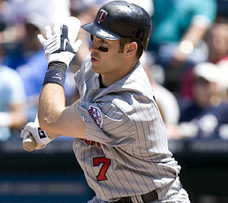 Joe Mauer ups his average to .392. He needs eight more plate appearances to qualify for the league lead.  (AP)