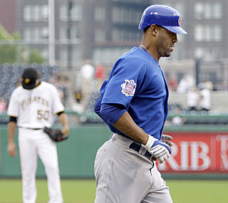 Derrek Lee gets the Cubs on the board early with a two-run shot in the first inning.  (AP)