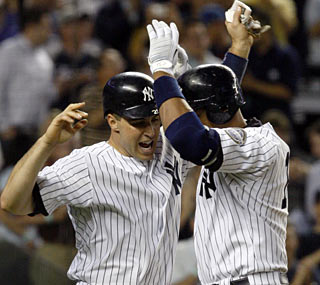 Alex Rodriguez (right) hits a tiebreaking homer in the later innings for the second night in a row.  (AP)