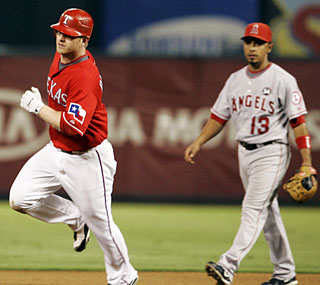 Hank Blalock's second home run of the game moves the Rangers to within a half-game of the Angels. (AP)