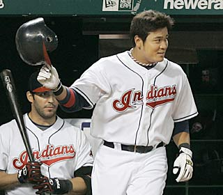 Shin-Soo Choo takes a curtain call after going 4 for 5 with two homers and seven RBI.  (AP)