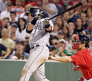 Rob Johnson's third hit -- a two-run double -- helps the M's continue their winning ways.  (AP)