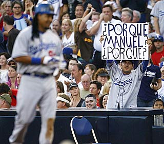 This Dodgers fan is looking for answers from Manny, who finished serving a 50-game ban.  (Getty Images)