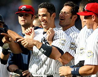 More happy times in the Bronx as Jorge Posada is cheered after his single wins it for N.Y. (Getty Images)