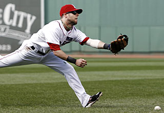 Dustin Pedroia can't get to Chris Woodward's game-winning RBI single in the ninth inning. (AP)