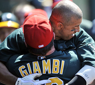 After his home run in the ninth inning, Orlando Cabrera embraces teammate Jason Giambi.  (AP)
