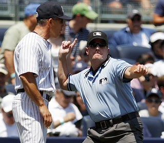 Joe Girardi might not even need a shower since he's tossed in the first inning by Marty Foster.  (US Presswire)