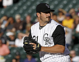 The Rockies' Jason Marquis takes the lead in the majors by winning his 11th game of the season.  (AP)