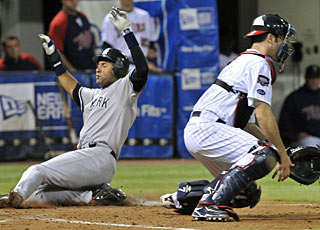 Derek Jeter beats the throw to Joe Mauer and scores on a single by Alex Rodriguez. (AP)