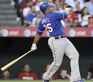 Andruw Jones provides plenty of power for the Rangers in the form of three homers -- in his first three at-bats.  (AP)