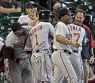 Nyjer Morgan (1) scores and the Nationals revel in the anomaly of a walk-off victory on the road.  (US Presswire)