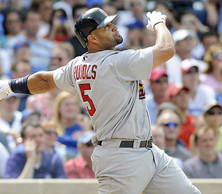 This one has the distance. Albert Pujols gives the Cards the lead with a homer off Rich Harden. (AP)
