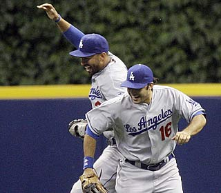 Matt Kemp, left, and Andre Ethier celebrate as the Dodgers secure the best record before the break.  (AP)