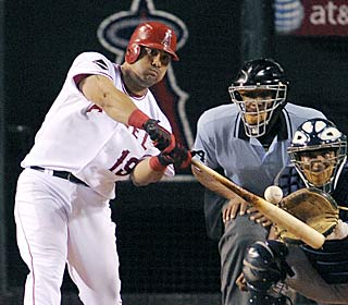 Kendry Morales crushes his 15th homer to help the Halos end the Yanks' eight-game road win streak.  (AP)