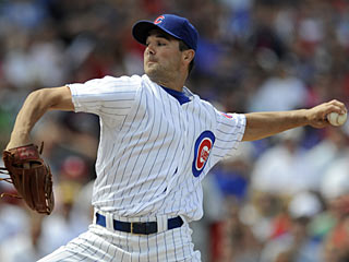 It takes Ted Lilly 10 years, but he gets to win No. 100 after a 103-pitch outing. (AP)