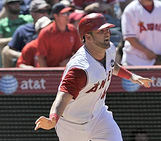 Mike Napoli hits his 11th homer of the season and drives in three to rally the Angels.  (AP)