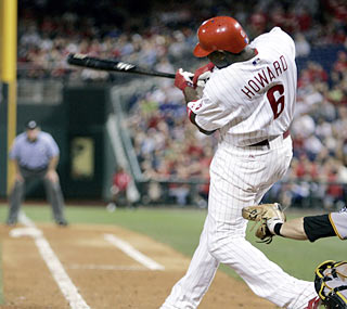 Ryan Howard helps the Phillies' rally by unleashing a game-tying, three-run shot in the ninth.  (AP)