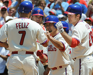 Welcome home party: Pedro Feliz receives props following his first-inning grand slam.  (US Presswire)