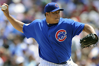 Carlos Zambrano fans seven over six innings and hits his 19th career homer in the Cubs victory.  (AP)