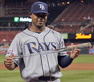 Tampa Bay's Carl Crawford inspects his prize after earning MVP honors in the All-Star Game.