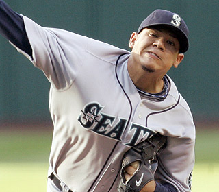 Felix Hernandez has another characteristic start. He strikes out eight and lowers his ERA to 2.51. (AP)