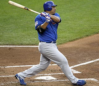 Carlos Zambrano connects with a double to drive in two runs and help his cause for the win. (AP)