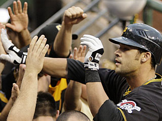 Lots of high-fives from teammates come Garrett Jones' way after hitting his second homer of the game. (AP)