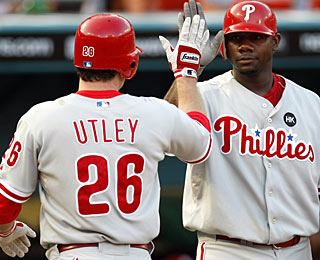 Ryan Howard appreciates Chase Utley's home run (21) in the first inning. (AP)