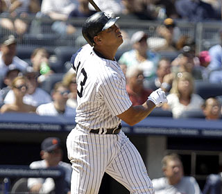 A-Rod watches his HR -- which looks like a pop fly at first -- go into the second row of seats.  (AP)