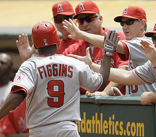 Chone Figgins starts the onslaught with a leadoff homer. He finishes 2 for 3 with three runs scored.  (AP)