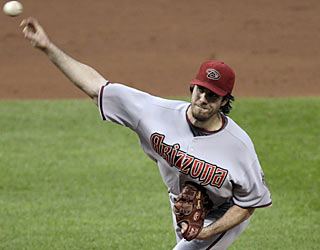Dan Haren picks up his 10th win and continues to drop his major league-best ERA as it sinks down to 1.96.  (AP)