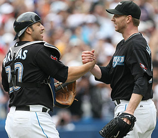 Roy Halladay (right) throws 78 of 105 pitches for strikes in the 44th complete game of his career.  (US Presswire)