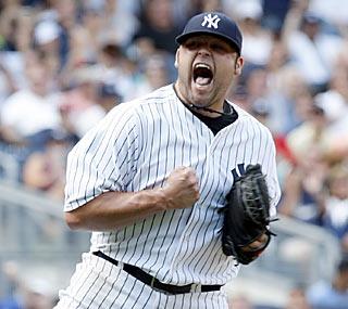 Joba Chamberlain has good reason to be ecstatic as he reels in his first win since June 24.  (US Presswire)