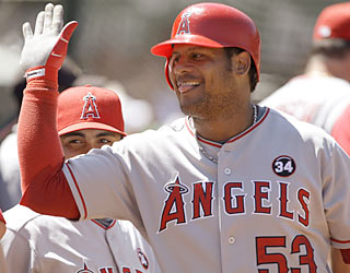 Bobby Abreu makes his teammates happy by providing both the team's first hit and game-winning run.  (AP)