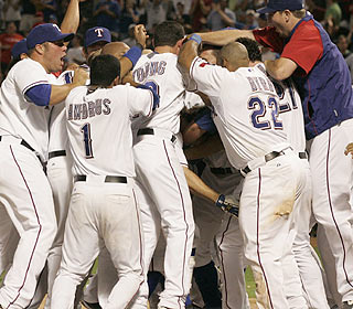 He gets lost in the scrum, but Ian Kinsler's walk-off homer sets off a celebration in Arlington. (AP)
